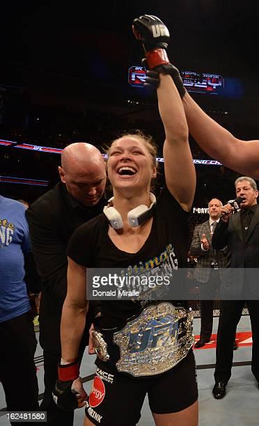 President Dana White puts the UFC women's bantamweight title belt around Ronda Rousey after women's bantamweight title fight during UFC 157 at Honda...