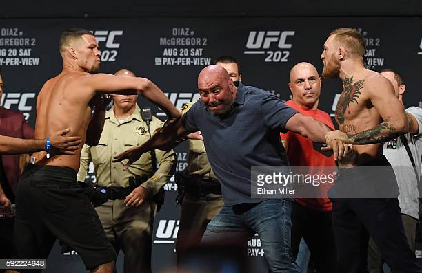 President Dana White separates mixed martial artist Nate Diaz and UFC featherweight champion Conor McGregor as they face off during their weighin for...