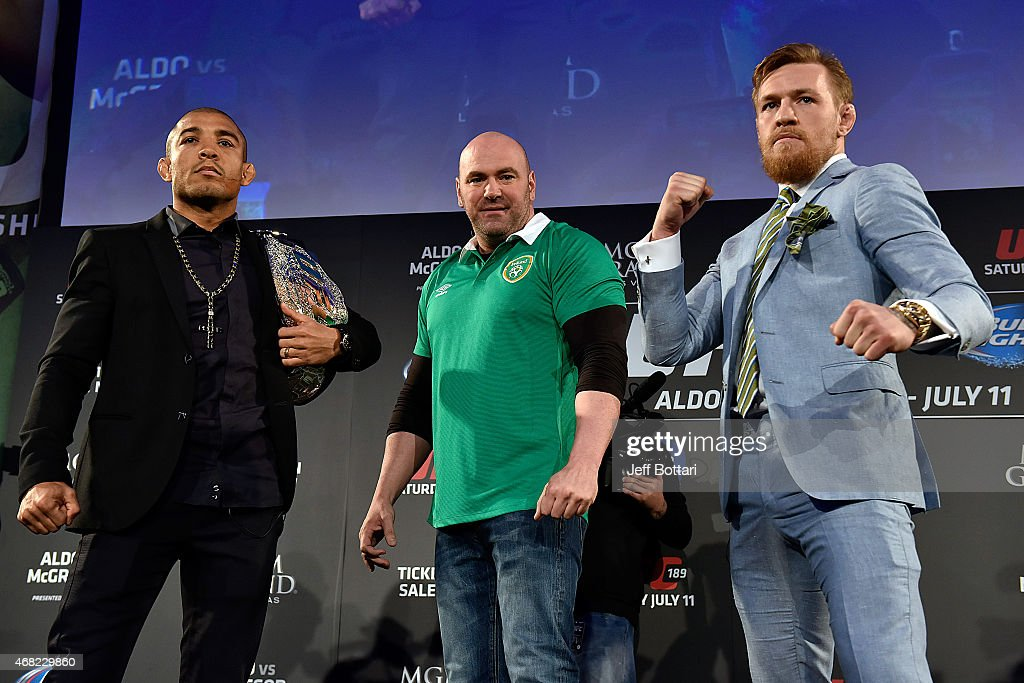 President Dana White (C) separates UFC Featherweight Champion Jose Aldo of Brazil (L) and title challenger Conor 'The Notorious' McGregor of Ireland (R) as they face off during the UFC 189 World Championship Fan Event on March 31, 2015 in Dublin, Ireland.
