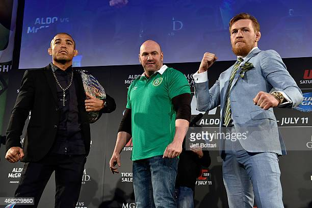 President Dana White separates UFC Featherweight Champion Jose Aldo of Brazil and title challenger Conor 'The Notorious' McGregor of Ireland as they...