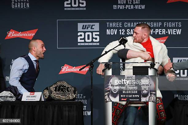 UFC president Dana White seperates Conor McGregor and Eddie Alvarez during the UFC 205 press conference at The Theater at Madison Square Garden on...