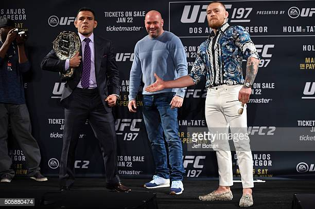 President Dana White squares off Rafael dos Anjos of Brazil and Conor McGregor of Ireland during the UFC 197 onsale press conference event inside MGM...