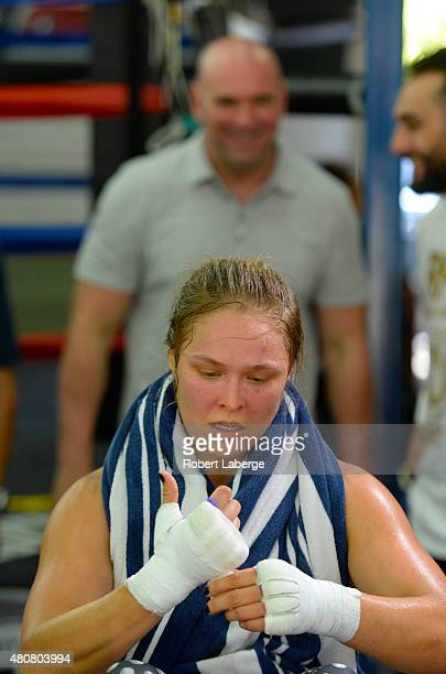 UFC president Dana White watches UFC Bantamweight champion Ronda Rousey during a media training session at the Glendale Fight Club on July 15 2015 in...