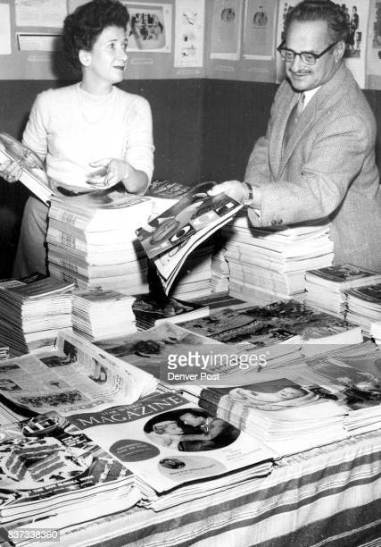 EXAMPLE President Dave Raffelock and Marion Neet of the National Writers Club arrange stacks of magazines for use in the Denverbased club's seventh...