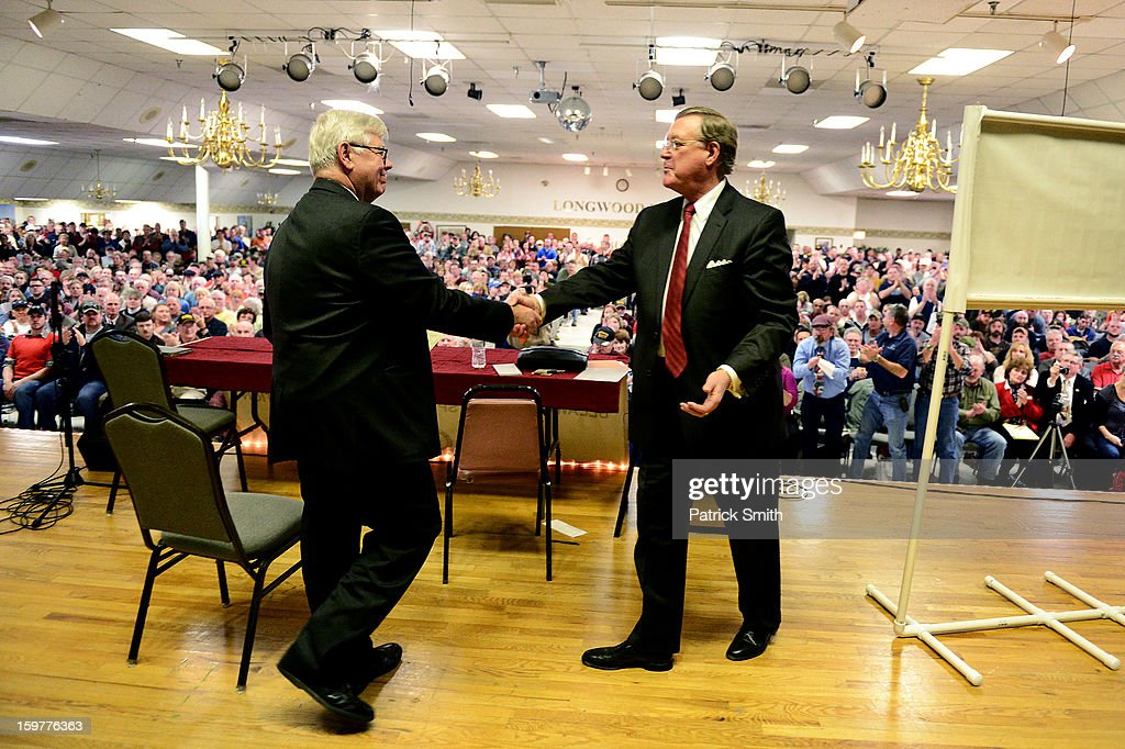 President David Keene (L) shakes the hand of former NRA President John Sigler before speaking to supporters during the Delaware State Sportsmen's Association Second Amendment rally at the Modern Maturity Center on January 20, 2013 in Dover, Delaware. U.S. President Barack Obama recently unveiled a package of gun control proposals that include universal background checks and bans on assault weapons and high-capacity magazines.