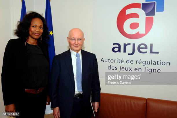 President de l'ARJEL Charles Coppolani poses with the Minister of Sports Laura Flessel during the visits the ARJEL on September 22 2017 in Paris...