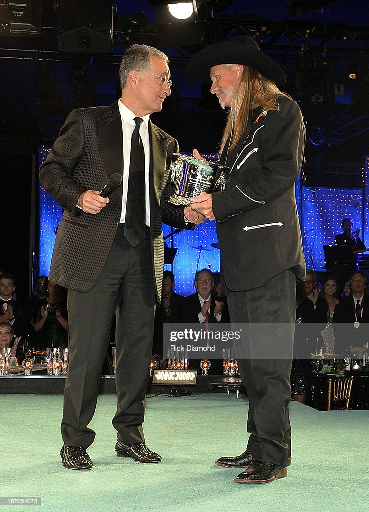 President <a gi-track='captionPersonalityLinkClicked' href=/galleries/search?phrase=Del+Bryant&family=editorial&specificpeople=239201 ng-click='$event.stopPropagation()'>Del Bryant</a> presents BMI Icon Award to songwriter Dean Dillon onstage during the 61st annual BMI Country Awards on November 5, 2013 in Nashville, Tennessee.