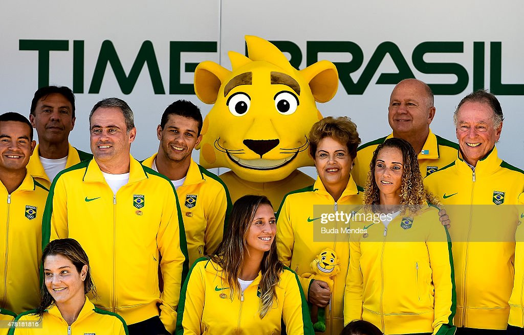 President Dilma Rousseff of Brazil (4th R) poses with Ginga, the Brazilian national Olympic team's new mascot and Olympic team members after Ginga was introduced by the Brazilian Local Organizing Committee at Parque Aquatico Maria Lenk on June 23, 2015 in Rio de Janeiro, Brazil.