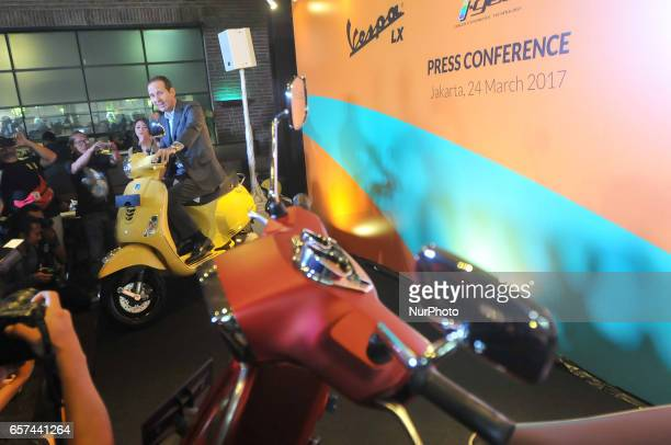 President Director of Piaggio Indonesia Marco Noto La Diega ride the bike at the launch of the Vespa LX and S iget 125cc in Jakarta on March 24 2017...