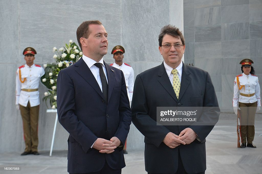 President Dmitri Medvedev (L) talks with Cuban Foreign Minister Bruno Rodriguez (R) during a wreath-laying ceremony at Revolution Square in Havana, on February 21, 2013. Medvedev is in Cuba in a three-day official visit.
