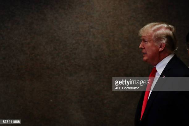 US President Donald J Trump arrives before the opening ceremony of the 31st Association of Southeast Asian Nations Summit in Manila on November 13...