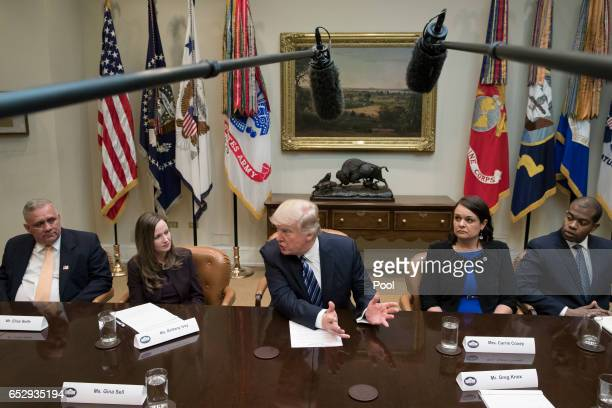President Donald J Trump attends a meeting on healthcare with opponents of the Affordable Care Act in the Roosevelt Room of the White House on March...