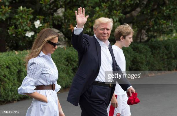 US President Donald J Trump boards Marine One with first lady Melania Trump and their son Barron Trump as they depart the White House for Camp David...