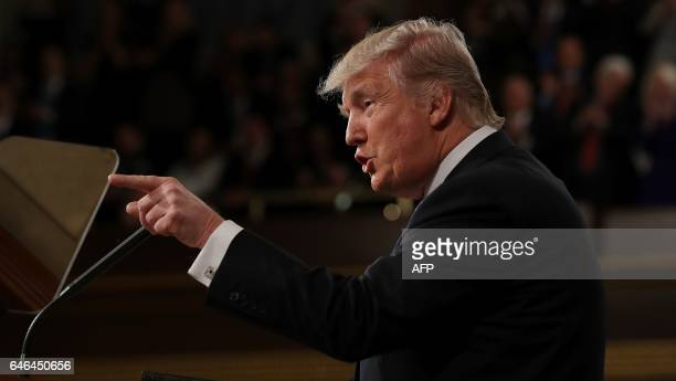 US President Donald J Trump delivers his first address to a joint session of Congress from the floor of the House of Representatives in Washington DC...