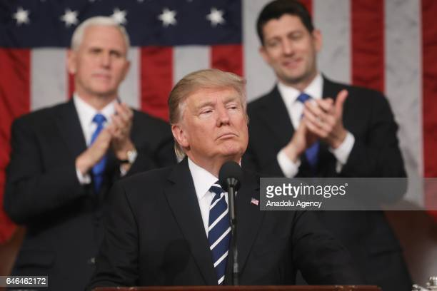 US President Donald J Trump delivers his first address to a joint session of Congress from the floor of the House of Representatives in Washington...