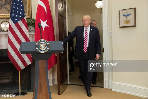 US President Donald J Trump enters for a joint statement with President of Turkey Recep Tayyip Erdogan in the Roosevelt Room of the White House on...