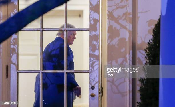 President Donald J Trump enters the Oval Office on March 5 2017 in Washington DC Trump is returning from a weekend at his MaraLago clu in Palm Beach...