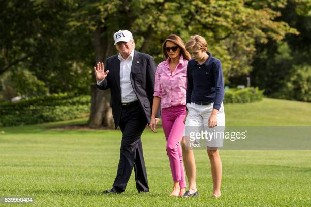 President Donald J Trump first lady Melania Trump and their son Barron Trump exit Marine One on the South Lawn August 27 2017 in Washington DC Trump...