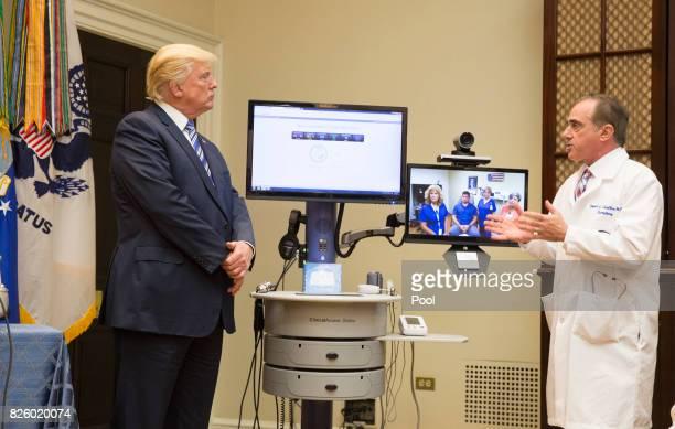 US President Donald J Trump listens to Veterans Affairs Secretary DrDavid Shulkin explain medical equipment to be used by the Department of Veterans...
