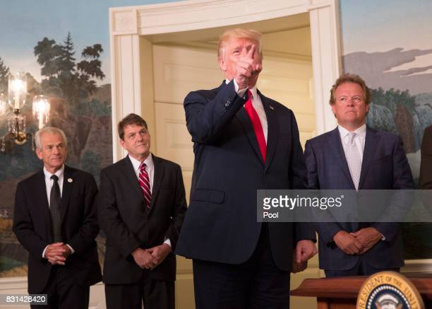 US President Donald J Trump responds to a question from CNN reporter Jim Acosta after signing a memorandum addressing China's laws policies practices...