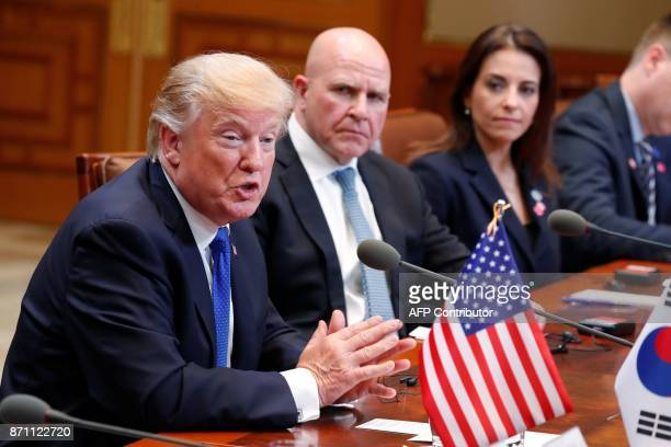 US President Donald J Trump sits beside National Security Advisor HR McMaster as he talks with South Korea's President Moon JaeIn during their summit...