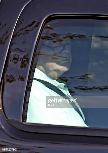 US President Donald J Trump sits in his limo as he departs the Trump National Golf Club October 22 2017 in Sterling Virginia