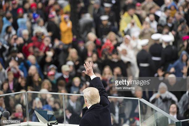 President Donald J Trump waves to the crowd after he was sworn in as the 45th President of the United States on the West Front of the Capitol January...