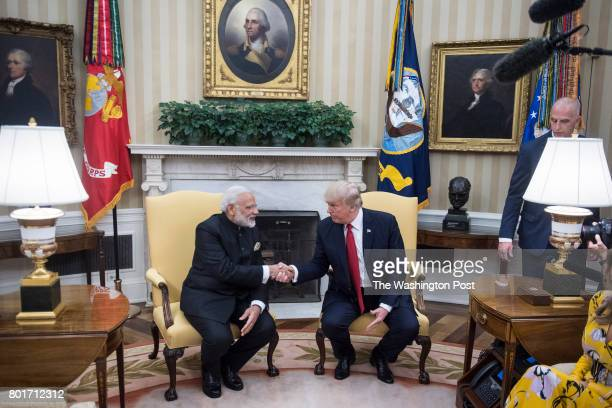 President Donald Trump accompanied by first lady Melania Trump meets with Indian Prime Minister Narendra Modi in the Oval Office of the White House...