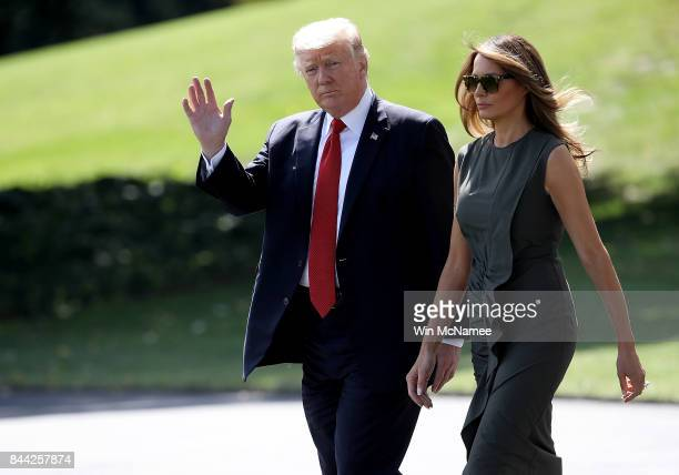 President Donald Trump accompanied by first lady Melania Trump departs the White House for Camp David September 8 2017 in Washington DC Trump is...