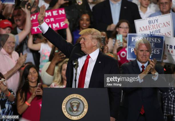 S President Donald Trump acknowledges supporters as Vice President Mike Pence looks on during a 'Make America Great Again Rally' at the Pennsylvania...