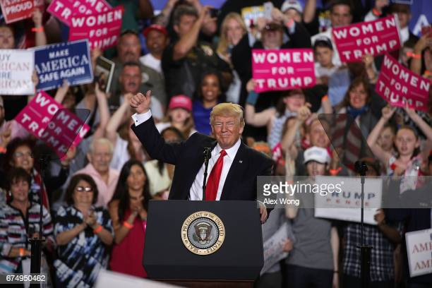 S President Donald Trump acknowledges supporters during a 'Make America Great Again Rally' at the Pennsylvania Farm Show Complex Expo Center April 29...