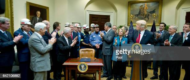 S President Donald Trump acknowledges the coal miners in attendance prior to signing HJ Res 38 disapproving the rule submitted by the US Department...