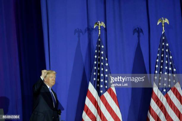 S President Donald Trump acknowledges the crowd after speaking at the Indiana State Fairgrounds Event Center September 27 2017 in Indianapolis...
