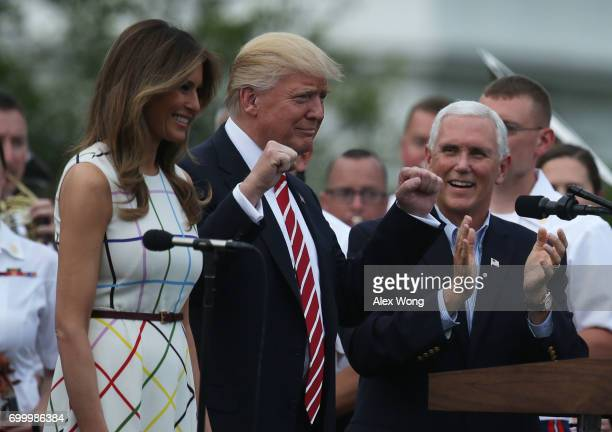 S President Donald Trump acknowledges the crowd as first lady Melania Trump and Vice President Mike Pence look on during a Congressional Picnic on...