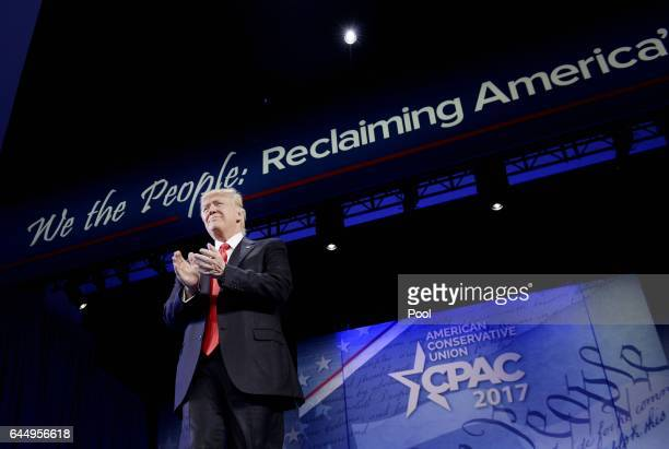 US President Donald Trump acknowledges the crowd at the Conservative Political Action Conference on February 24 2017 in National Harbor Maryland...