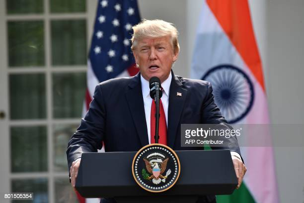 US President Donald Trump addresses a joint press conference with Indian Prime Minister Narendra Modi in the Rose Garden at The White House in...