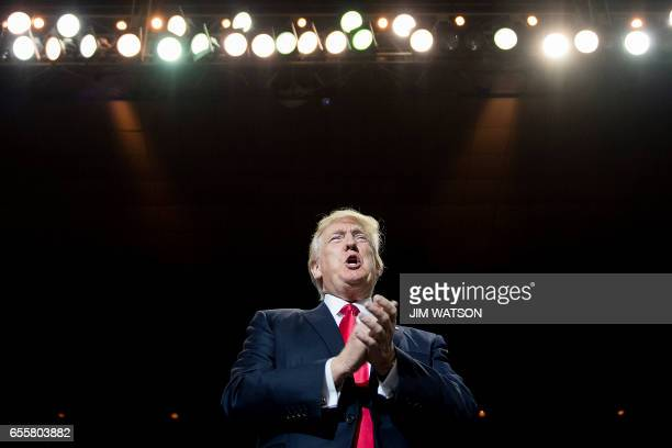 President Donald Trump addresses a 'Make America Great Again' rally at the Kentucky Exposition Center in Louisville Kentucky March 20 2017 / AFP...