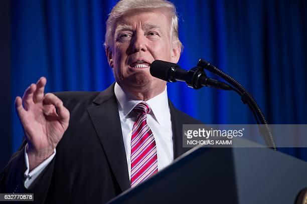 US President Donald Trump addresses a Republican retreat in Philadelphia on January 26 2017 / AFP / NICHOLAS KAMM