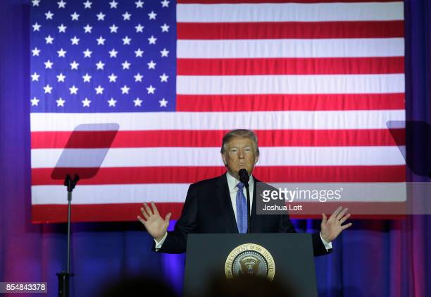 S President Donald Trump addresses supporters as he speaks at the Indiana State Fairgrounds Event Center September 27 2017 in Indianapolis Indiana...