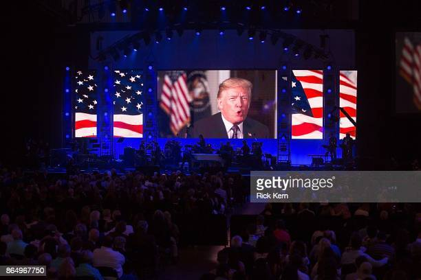 President Donald Trump addresses the audience during the 'Deep from the Heart The One America Appeal Concert' at Reed Arena on the campus of Texas AM...