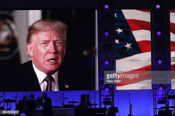 President Donald Trump addresses the audience via a taped message during the 'Deep From The Heart One America Appeal Concert' at Reed Arena on...