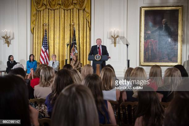 US President Donald Trump addresses the Womens Empowerment Panel in the East Room of the White House in Washington DC on March 29 2017 Seated from L...
