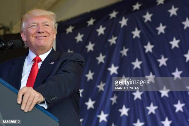 US President Donald Trump addresses US military personnel and families at Naval Air Station Sigonella after G7 summit of Heads of State and...