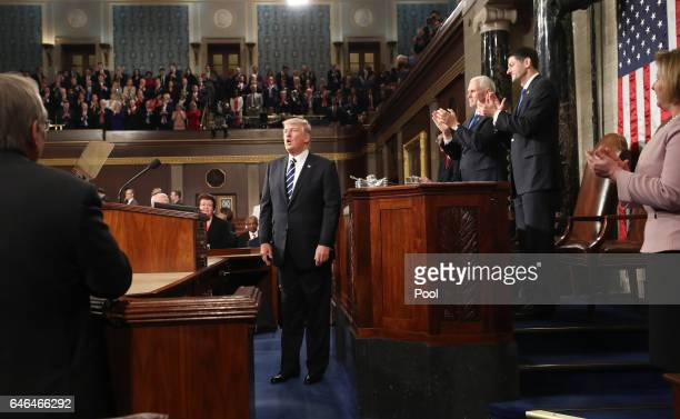 US President Donald Trump after delivering his first address to a joint session of Congress on February 28 2017 in the House chamber of the US...