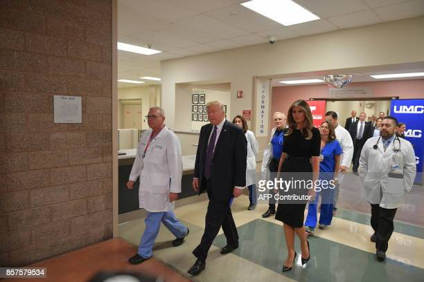 President Donald Trump along with First Lady Melania Trump walks after visiting with staff and shooting survivors at University Medical Center in Las...
