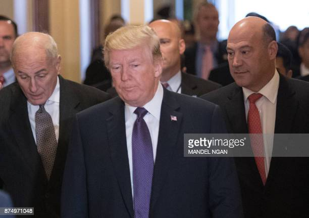 US President Donald Trump along with White House Chief of Staff John Kelly and Director of the National Economic Council Gary Cohn arrives for a...