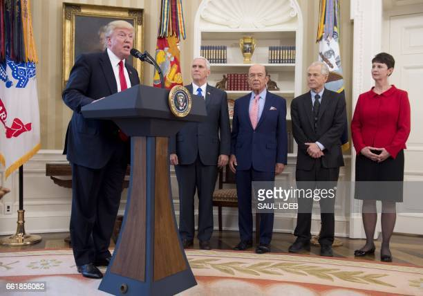 US President Donald Trump alongside US Vice President Mike Pence Commerce Secretary Wilbur Ross and Peter Navarro director of the National Trade...