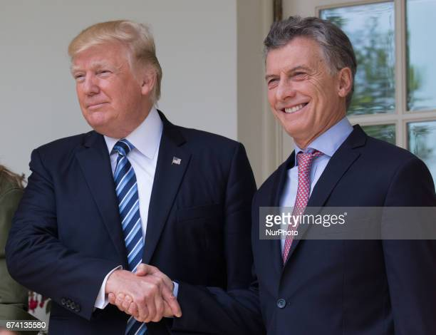 President Donald Trump and Argentina's President Mauricio Macri shake hands in the West Wing Colonnade of the White House in Washington DC on...