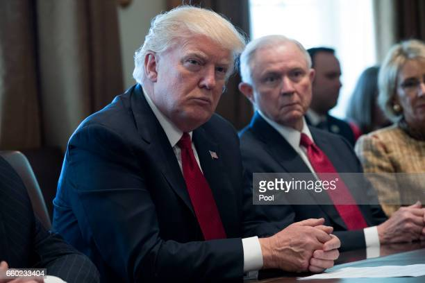 S President Donald Trump and Attorney General Jeff Sessions attend a panel discussion on an opioid and drug abuse in the Roosevelt Room of the White...