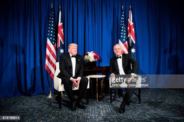 US President Donald Trump and Australian Prime Minister Malcolm Turnbull await the start of a meeting on board the Intrepid Sea Air and Space Museum...